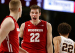 Wisconsin forward Ethan Happ (22) celebrates with teammate Brevin Pritzl (1) as Minnesota guard Gabe Kalscheur (22) walks off after an NCAA college basketball game Wednesday, Feb. 6, 2019, in Minneapolis. Wisconsin defeated Minnesota 56-51. (AP Photo/Andy Clayton-King)