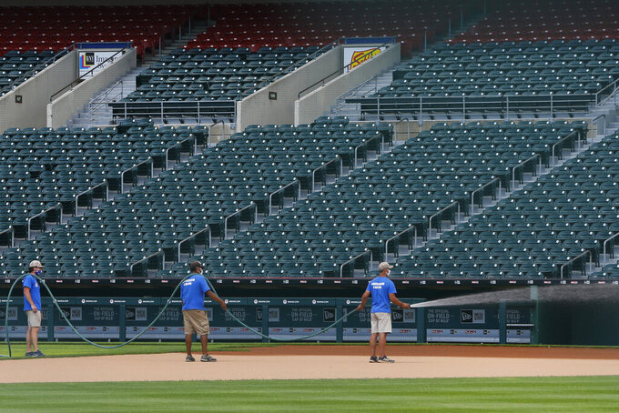 Grounds crew work on field following the announcement that the Toronto Blue Jays will play their 2020 home games at Sahlen Field, their Triple-A affiliate, Friday, July 24, 2020, in Buffalo N.Y. (AP Photo/Jeffrey T. Barnes)