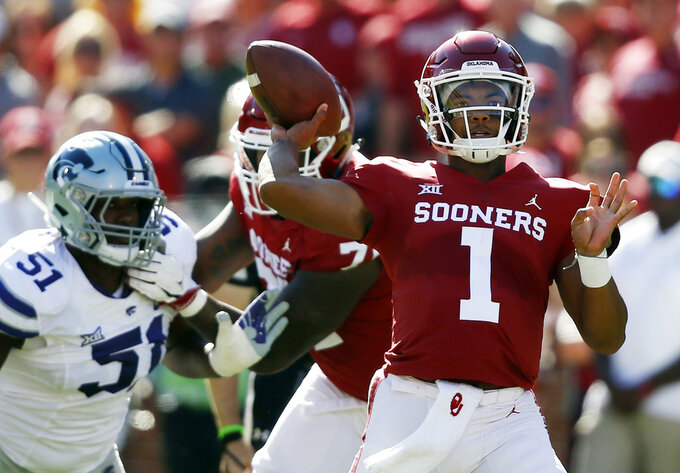 Oklahoma QB Kyler Murray on record pace by spreading wealth