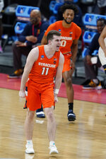Syracuse's Joseph Girard III (11) reacts after hitting a three point shot during the first half of a second-round game against West Virginia in the NCAA men's college basketball tournament at Bankers Life Fieldhouse, Sunday, March 21, 2021, in Indianapolis. (AP Photo/Darron Cummings)