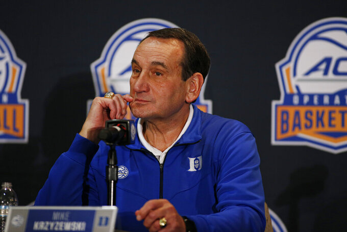 Duke coach Mike Krzyzewski listens to a question during the Atlantic Coast Conference NCAA college basketball media day in Charlotte, N.C., Tuesday, Oct. 8, 2019. (AP Photo/Nell Redmond)