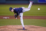 Atlanta Braves starting pitcher Max Fried (54) delivers during the third inning of a baseball game against the Boston Red Sox, Monday, Aug. 31, 2020, in Boston. (AP Photo/Charles Krupa)