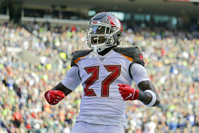 Tampa Bay Buccaneers running back Ronald Jones celebrates after scoring a touchdown against the Seattle Seahawks during the first half of an NFL football game, Sunday, Nov. 3, 2019, in Seattle. (AP Photo/John Froschauer)