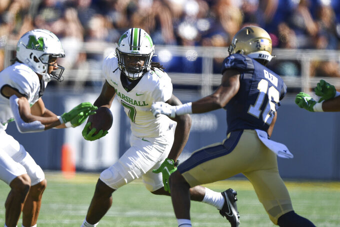 Marshall wide receiver Corey Gammage (7) runs the ball against Navy cornerback Jamal Glenn (16) during the first half of an NCAA college football game, Saturday, Sept. 4, 2021, in Annapolis, Md. (AP Photo/Terrance Williams)