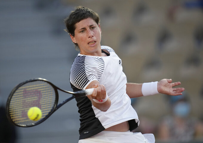 Spain's Carla Suarez Navarro plays a return to United States's Sloane Stephens during their first round match on day three of the French Open tennis tournament at Roland Garros in Paris, France, Tuesday, June 1, 2021. (AP Photo/Christophe Ena)