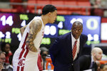 Washington State coach Ernie Kent, right, speaks with forward Isaiah Wade before Wade entered the first half of the team's NCAA college basketball game against Oregon in Pullman, Wash., Wednesday, March 6, 2019. (AP Photo/Young Kwak)
