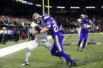 New Orleans Saints Taysom Hill pulls in touchdown reception against Minnesota Vikings free safety Harrison Smith (22) in the second half of an NFL wild-card playoff football game, Sunday, Jan. 5, 2020, in New Orleans. (AP Photo/Brett Duke)