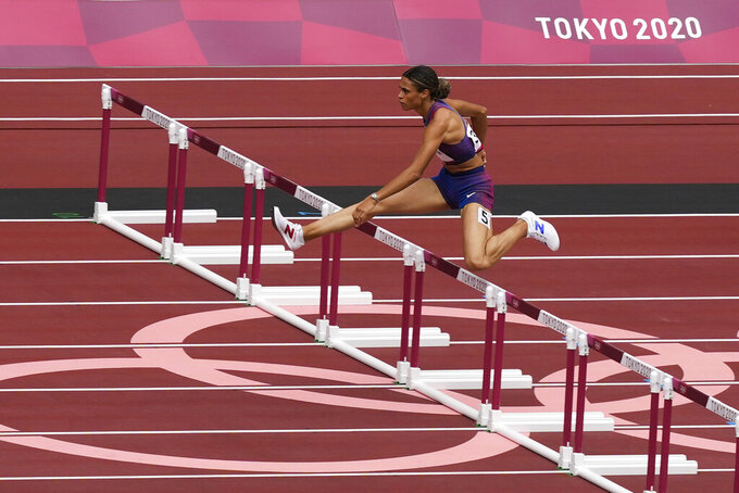 Sydney Mclaughlin, of United States, wins a heat in the women's 400-meter hurdles at the 2020 Summer Olympics, Saturday, July 31, 2021, in Tokyo. (AP Photo/Martin Meissner)