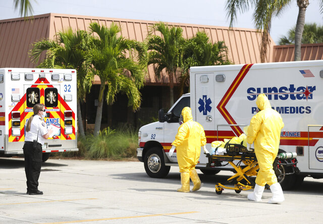 The remaining residents are evacuated from Freedom Square of Seminole, Friday, April 17, 2020. in Seminole, Fla. Three nursing home residents have died of the coronavirus in an outbreak that has afflicted Freedom Square of Seminole, a sprawling retirement community that has seen dozens of residents hospitalized because of the virus, officials said. (Dirk Shadd/Tampa Bay Times via AP)