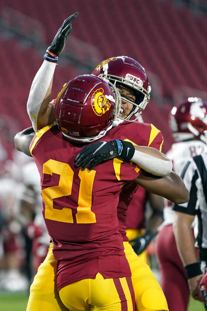 Southern California wide receiver Amon-Ra St. Brown, right, celebrates a touchdown catch with wide receiver Tyler Vaughns during the first half of an NCAA college football game against Washington State in Los Angeles, Sunday, Dec. 6, 2020. (AP Photo/Alex Gallardo)