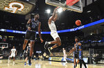 Georgia Tech's forward Moses Wright (5) hangs from the basket after dunking during the first half against Duke in an NCAA college basketball game Tuesday, March 2, 2021, in Atlanta. (Hyosub Shin/Atlanta Journal-Constitution via AP)
