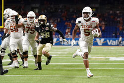 Texas running back Bijan Robinson (5) runs for a touchdown against Colorado during the first half of the Alamo Bowl NCAA college football game Tuesday, Dec. 29, 2020, in San Antonio. (AP Photo/Eric Gay)