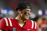 Mississippi quarterback Matt Corral smiles after the team's 61-21 win over Tulane in an NCAA college football game Saturday, Sept. 18, 2021, in Oxford, Miss. (AP Photo/Rogelio V. Solis)