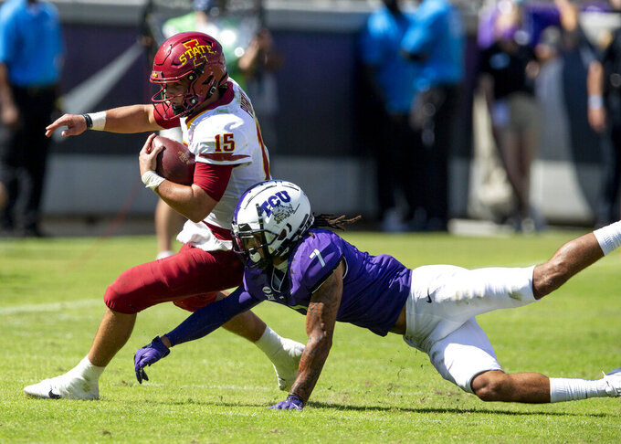 TCU safety Trevon Moehrig (7) tackles Iowa State quarterback Brock Purdy (15) during an NCAA college football game on Saturday, Sept. 26, 2020 in Fort Worth, Texas. Iowa won 37-34. (AP Photo/Brandon Wade)
