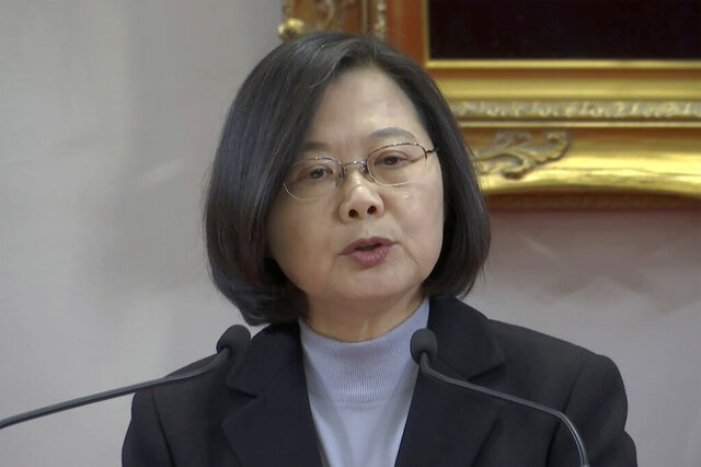 In this image made from a video, Taiwan President Tsai Ing-wen gives an annual New Year's statement to the media in Taipei, Taiwan Wednesday, Jan. 1, 2020. (APTN via AP)