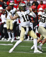 Wake Forest quarterback Sam Hartman (10) attempts a pass during the first half of an NCAA college football game, Saturday, Oct. 27, 2018, in Louisville, Ky. (AP Photo/Timothy D. Easley)