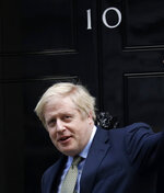 FILE - In this file photo dated Friday, Dec. 13, 2019, Britain's Prime Minister Boris Johnson returns to 10 Downing Street after meeting with Queen Elizabeth II at Buckingham Palace, London.  During the coming 2020 year Johnson will not have a warm relationship with EU leaders who hold much of the leverage in upcoming trade talks for Britain's split from Europe, and he faces the trickier task of holding the diverse parts of the UK together.(AP Photo/Matt Dunham, FILE)