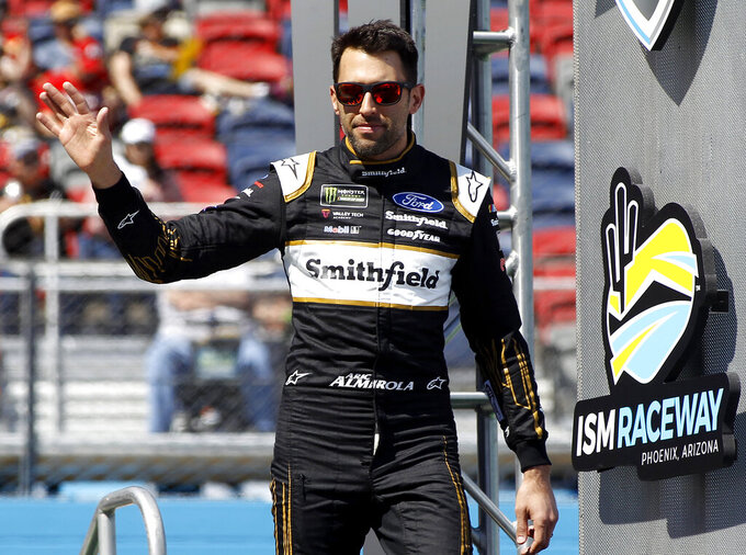 Aric Almirola waves to the crowd during driver introductions prior to the start of the NASCAR Cup Series auto race at ISM Raceway, Sunday, March 10, 2019, in Avondale, Ariz. (AP Photo/Ralph Freso)