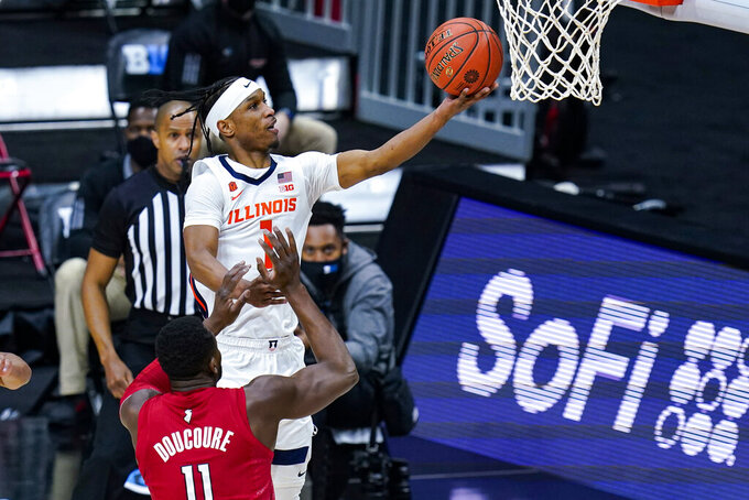Illinois guard Trent Frazier (1) shoots over Rutgers forward Mamadou Doucoure (11) during the first half of an NCAA college basketball game at the Big Ten Conference tournament in Indianapolis, Friday, March 12, 2021. (AP Photo/Michael Conroy)