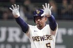 Milwaukee Brewers' Eduardo Escobar reacts after hitting a two-run scoring double during the third inning of a baseball game against the Philadelphia Phillies Tuesday, Sept. 7, 2021, in Milwaukee. (AP Photo/Morry Gash)