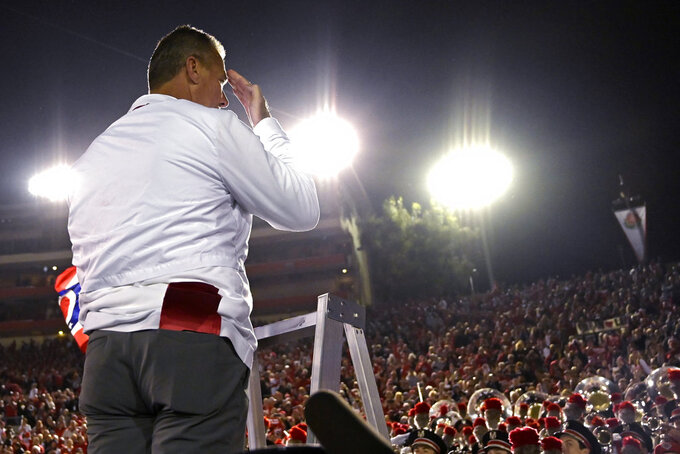 Ohio State coach Urban Meyer gestures to fans after Ohio State defeated Washington 28-23 in the Rose Bowl NCAA college football game Tuesday, Jan. 1, 2019, in Pasadena, Calif. (AP Photo/Mark J. Terrill)
