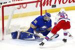 Buffalo Sabres goalie Linus Ullmark (35) stops New York Rangers forward Mika Zibanejad (93) during the shootout of an NHL hockey game, Saturday, April 3, 2021, in Buffalo, N.Y. (AP Photo/Jeffrey T. Barnes)