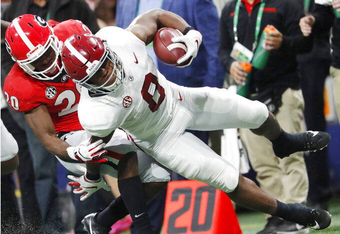Georgia defensive back J.R. Reed (20) brings down Alabama running back Josh Jacobs (8) during the first half of the Southeastern Conference championship NCAA college football game, Saturday, Dec. 1, 2018, in Atlanta. (AP Photo/John Bazemore)