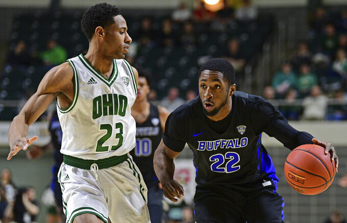 Buffalo guard Dontay Caruthers drives on Ohio guard Antonio Cowart Jr. during the first half of an NCAA college basketball game Tuesday, March 5, 2019, in Athens, Ohio. (AP Photo/David Dermer)