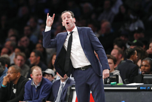 Brooklyn Nets head coach Kenny Atkinson gestures to his players during the second quarter of an NBA basketball game against the Memphis Grizzlies, Wednesday, March 4, 2020, in New York. (AP Photo/Kathy Willens)