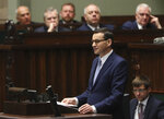 Poland's Prime Minister Mateusz Morawiecki vows to protect U.S. – EU ties and the crucial role of NATO, against criticism from some other European leaders, during his policy speech for his second term in office following October parliamentary elections, in Warsaw, Poland, Tuesday, Nov. 19, 2019. (AP Photo/Czarek Sokolowski)
