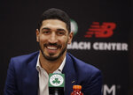 Newly acquired Boston Celtics center Enes Kanter smiles during a news conference at the Celtics' basketball practice facility, Wednesday, July 17, 2019, in Boston. (AP Photo/Elise Amendola)