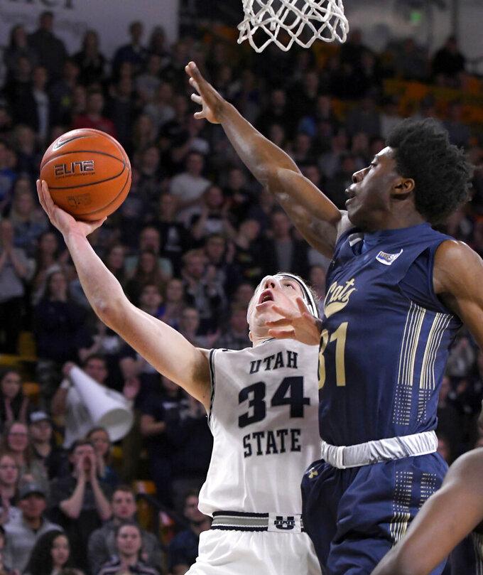 Utah State forward Justin Bean (34) takes a shot as Montana State forward Devin Kirby (31) defends during an NCAA college basketball game Tuesday, Nov. 5, 2019, in Logan, Utah. (Eli Lucero/The Herald Journal via AP)
