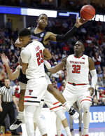Buffalo's Davonta Jordan passes around Texas Tech's Jarrett Culver (23) and Norense Odiase during the second half of a second round men's college basketball game in the NCAA Tournament Sunday, March 24, 2019, in Tulsa, Okla. (AP Photo/Jeff Roberson)