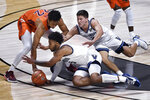 Virginia Tech's Keve Aluma, left, and Villanova's Justin Moore, center, and Collin Gillespie go for a loose ball during the first half of an NCAA college basketball game Saturday, Nov. 28, 2020, in Uncasville, Conn. (AP Photo/Jessica Hill)