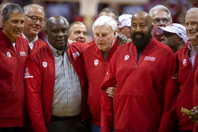 Former Indiana basketball head coach Bobby Knight, center, makes his first appearance at Indiana University since his dismissal in September of 2000. Knight, is surrounded by former players and staff during a ceremony with the Indiana players of the 1980 Big Ten championship team the halftime of an NCAA college basketball game, Saturday, Feb. 8, 2020, in Bloomington, Ind. (AP Photo/Doug McSchooler)