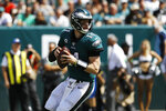 Philadelphia Eagles' Carson Wentz looks to pass during the first half of an NFL football game against the Washington Redskins, Sunday, Sept. 8, 2019, in Philadelphia. (AP Photo/Michael Perez)