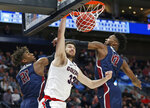 Gonzaga forward Killian Tillie (33) dunks between Fairleigh Dickinson's Elyjah Williams (21) and Kaleb Bishop (12) during the second half of a first-round game in the NCAA men's college basketball tournament Thursday, March 21, 2019, in Salt Lake City. (AP Photo/Rick Bowmer)