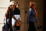 Kathleen Manafort, right, wife of former Trump campaign chairman Paul Manafort, arrives at the Albert V. Bryan United States Courthouse for her husbands trial, Friday, Aug. 10, 2018, in Alexandria, Va. (AP Photo/Evan Vucci)