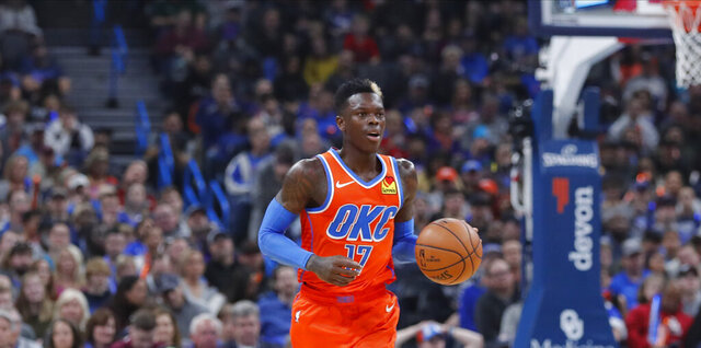 Oklahoma City Thunder guard Dennis Schroder (17) dribbles downcourt against the Los Angeles Clippers during the second quarter of an NBA basketball game Sunday, Dec. 22, 2019, in Oklahoma City. (AP Photo/Alonzo Adams)