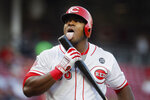 Cincinnati Reds' Yasiel Puig licks his bat after hitting a foul tip off Chicago Cubs starting pitcher Yu Darvish in the fourth inning of a baseball game, Wednesday, May 15, 2019, in Cincinnati. (AP Photo/John Minchillo)