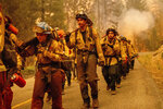Cal Fire firefighters battle the Dixie Fire near Prattville in Plumas County, Calif., on Friday, July 23, 2021. (AP Photo/Noah Berger)