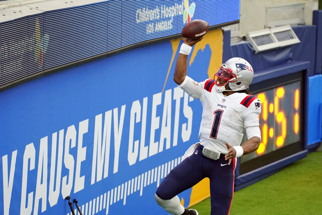 New England Patriots quarterback Cam Newton (1) celebrates after scoring during the first half of an NFL football game against the Los Angeles Chargers Sunday, Dec. 6, 2020, in Inglewood, Calif. (AP Photo/Ashley Landis)