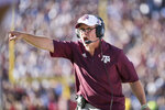 Texas A&M head coach Jimbo Fisher communicates with players during the first half of an NCAA college football game Saturday, Oct. 13, 2018, in Columbia, S.C. Texas A&M defeated South Carolina 26-23. (AP Photo/Sean Rayford)