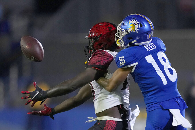 San Diego State wide receiver Isaiah Richardson, left, catches a pass against San Jose State cornerback Kenyon Reed (18) during the first half of an NCAA college football game Friday, Oct. 15, 2021, in San Jose, Calif. (AP Photo/Tony Avelar)