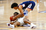 Villanova's Jermaine Samuels, bottom, and Connecticut's Andre Jackson battle for a loose ball during the second half of an NCAA college basketball game, Saturday, Feb. 20, 2021, in Villanova, Pa. (AP Photo/Matt Slocum)