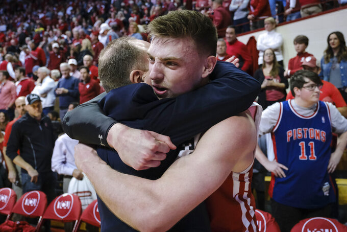 Wisconsin forward Micah Potter, right, hugs Wisconsin head coach Greg Gard after defeating Indiana 60-56 in an NCAA college basketball game in Bloomington, Ind., Saturday, March 7, 2020. (AP Photo/AJ Mast)