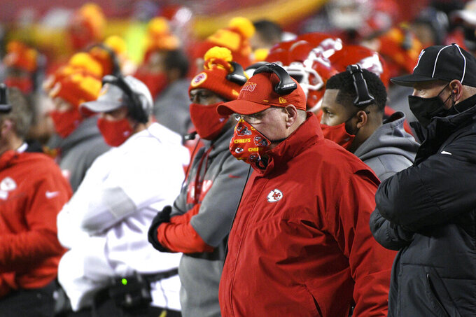 Kansas City Chiefs head coach Andy Reid watches from the sideline during the first half of the AFC championship NFL football game against the Buffalo Bills, Sunday, Jan. 24, 2021, in Kansas City, Mo. (AP Photo/Reed Hoffmann)