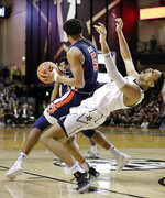 Auburn forward Chuma Okeke (5) collides with Vanderbilt forward Matthew Moyer (13) in the second half of an NCAA college basketball game Saturday, Feb. 16, 2019, in Nashville, Tenn. (AP Photo/Mark Humphrey)