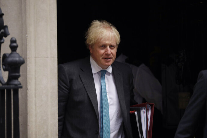 British Prime Minister Boris Johnson leaves 10 Downing Street in London, to attend the weekly Prime Minister's Questions at the Houses of Parliament, in London, Wednesday, Sept. 16, 2020. (AP Photo/Matt Dunham)
