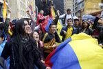 Students rally during a nationwide strike at the Bolivar square in downtown Bogota, Colombia, Thursday, Nov. 21, 2019. Colombia's main union groups and student activists called for a strike to protest the economic policies of Colombian President Ivan Duque government and a long list of grievances. (AP Photo/Fernando Vergara)